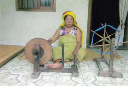 Hard at work behind the spinning wheel